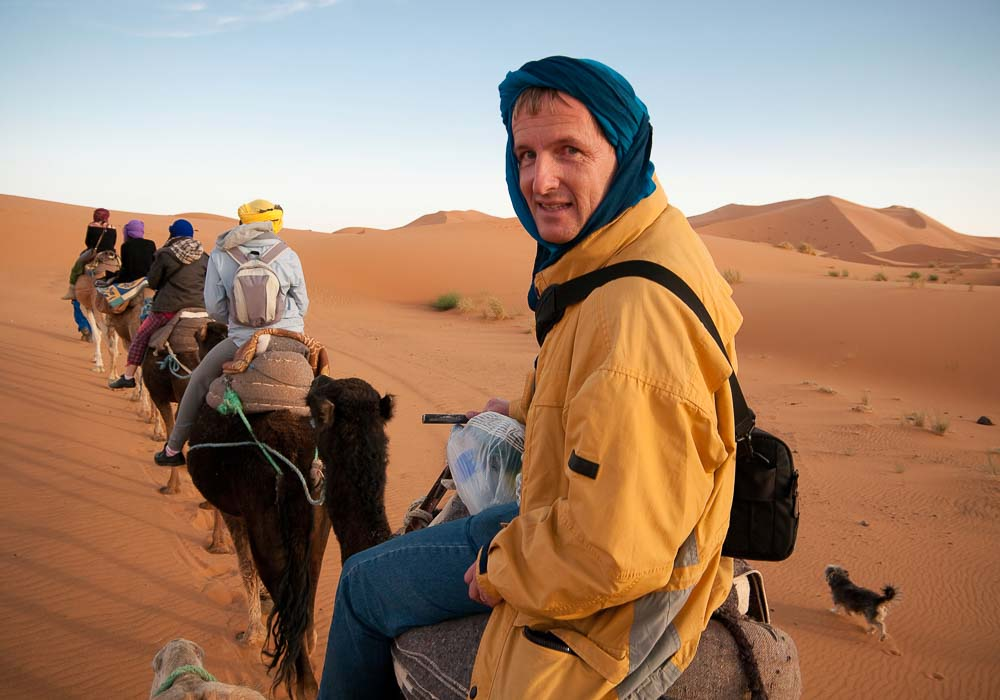 Man at the back of a camel train