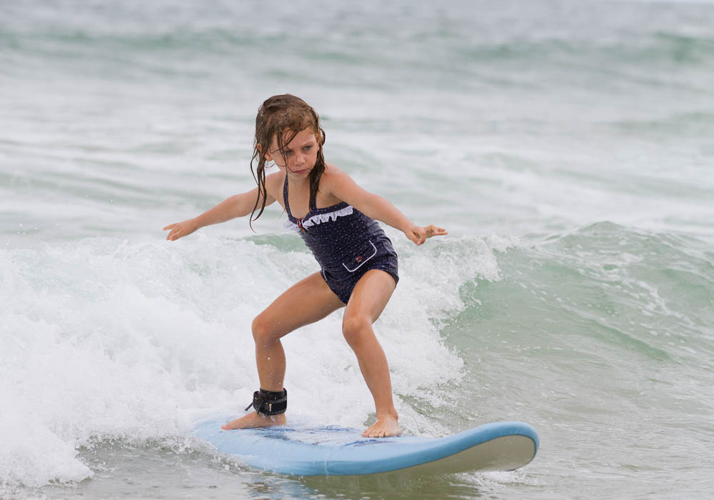 Little girl surfing