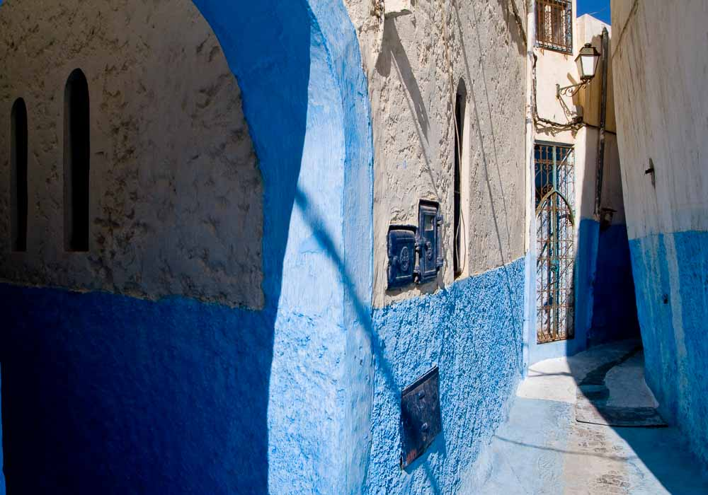 Beautiful small street with blue walls and nice shadows. Africa - Morocco - Rabat
