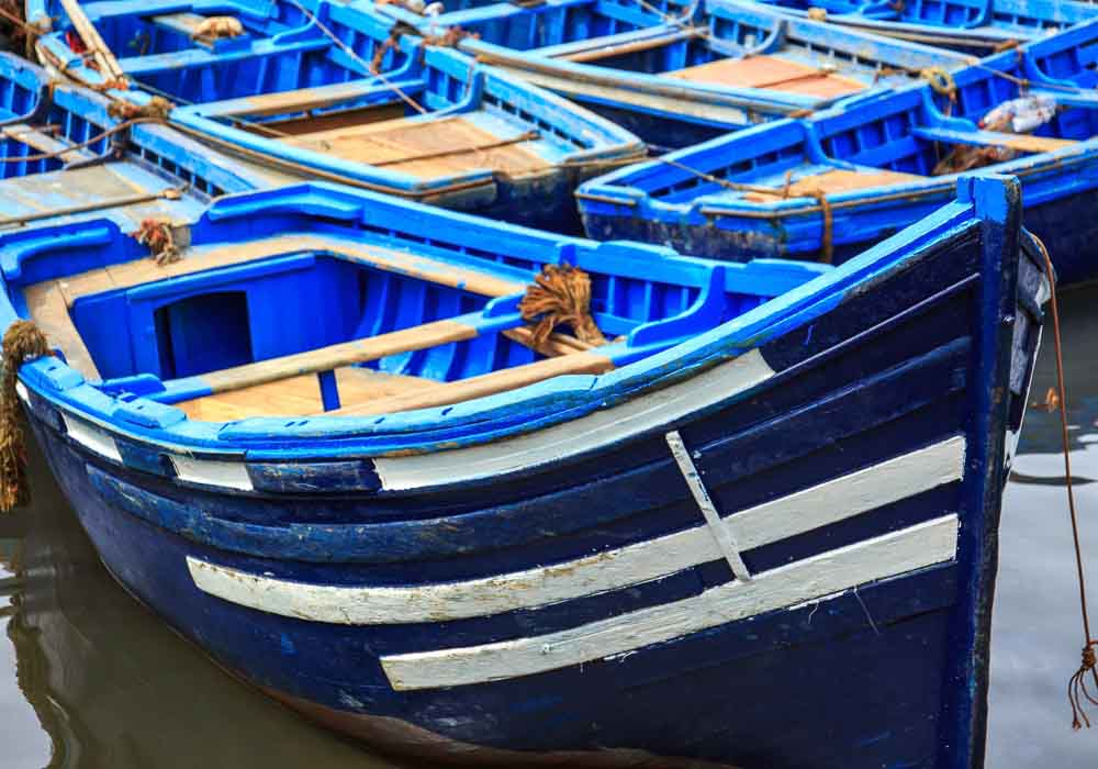 Beautiful blue boats in old Essaouira harbor, Morocco