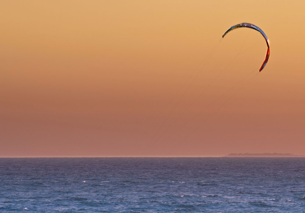 Kite surfing at dawn