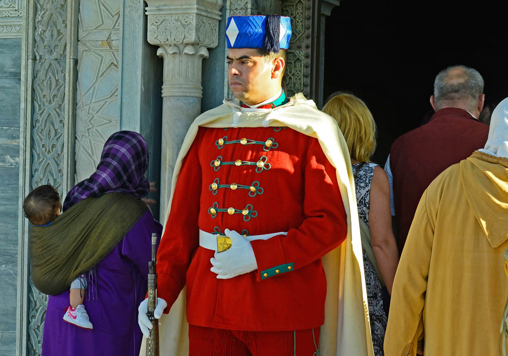 Rabat, Morocco - November 18th 2014: Unidentified armed guard in traditional uniform and nostalgic rifle in front of the mausoleum of Mohammed V.