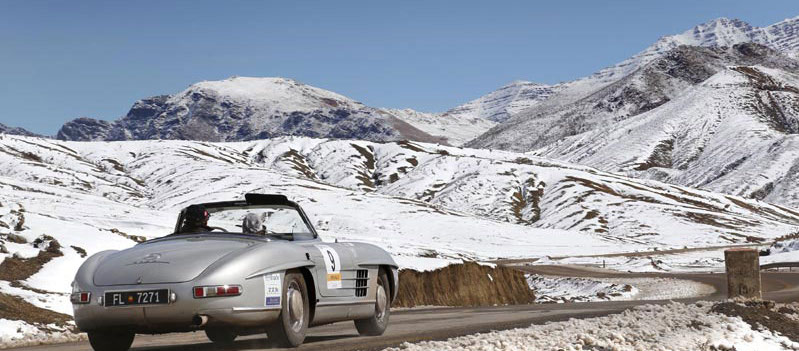 Classic car driving in Moroccan snow
