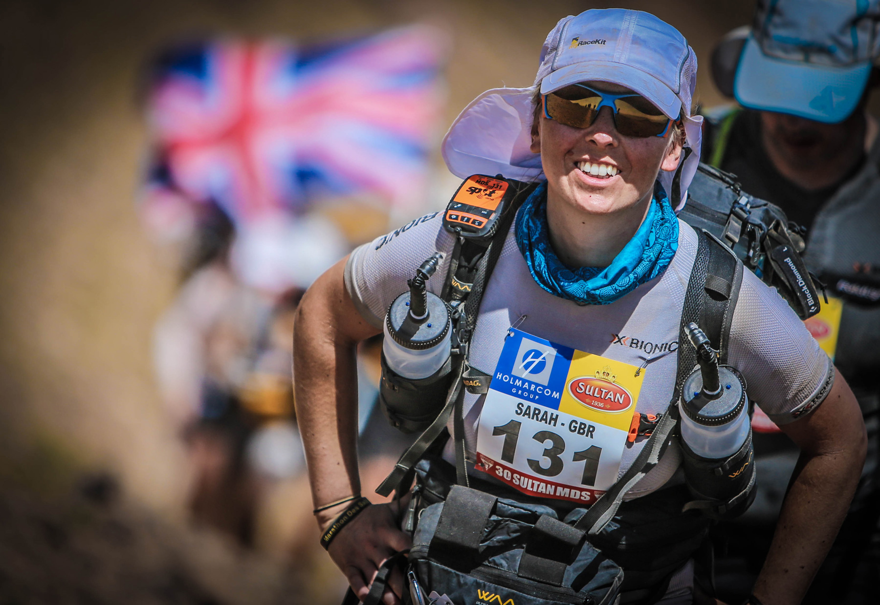 Sarah at front of long trail of competitors in desert