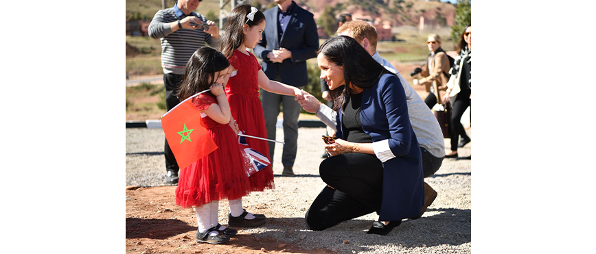 Meghan and Harry meeting small Moroccan girls